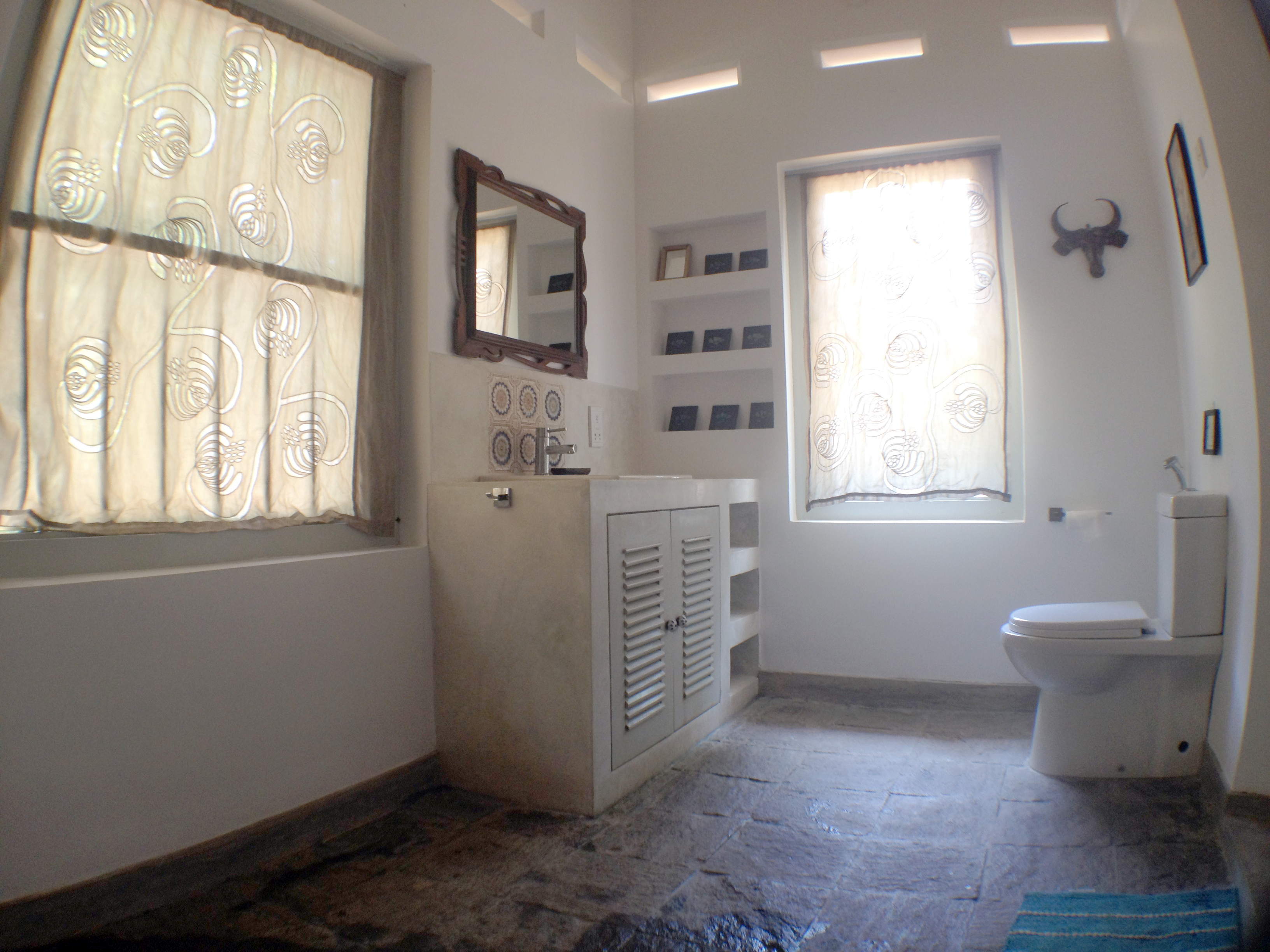A large bathroom with custom made cutwork blinds.