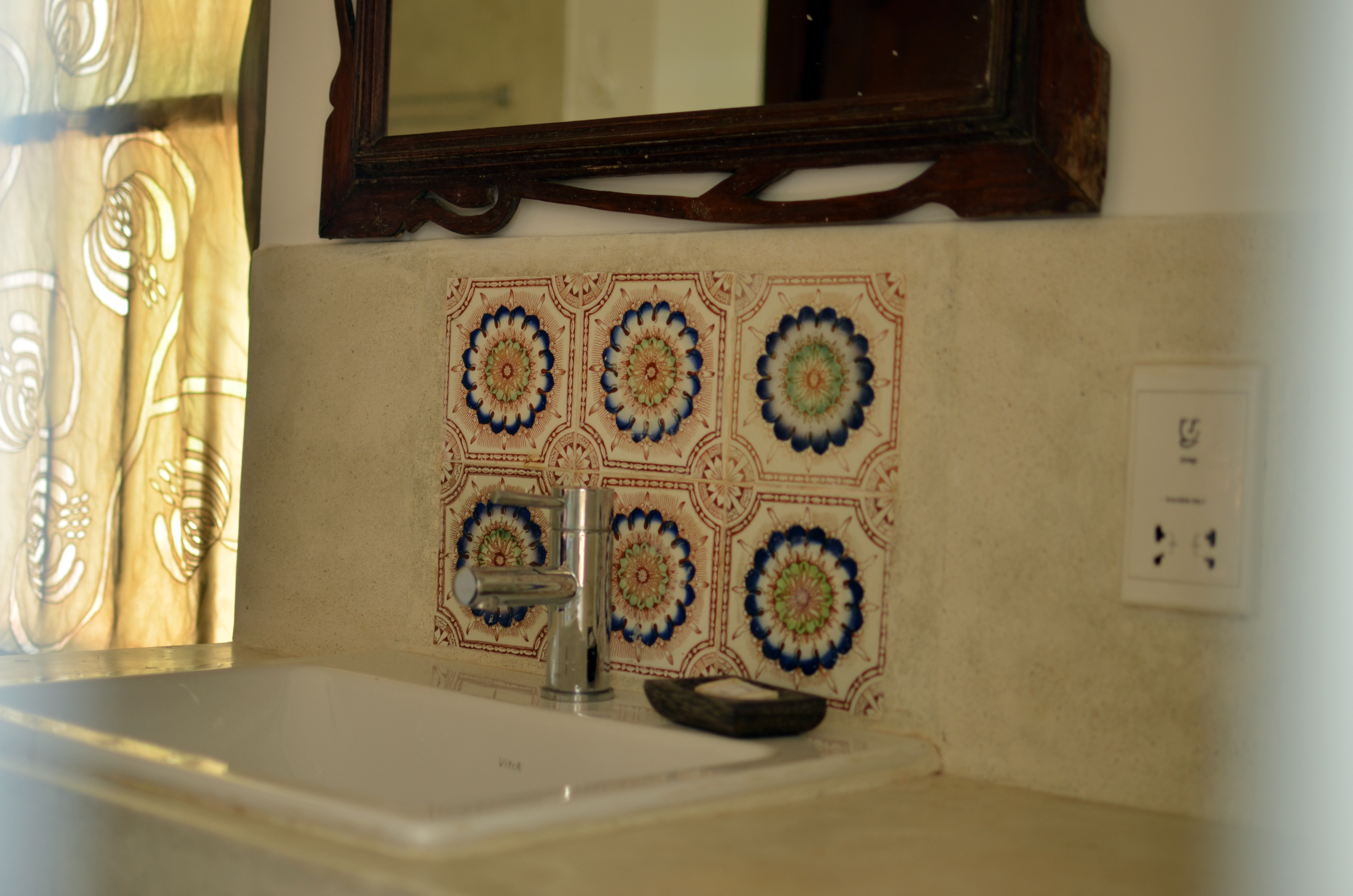 Basin with beautiful tile detail.