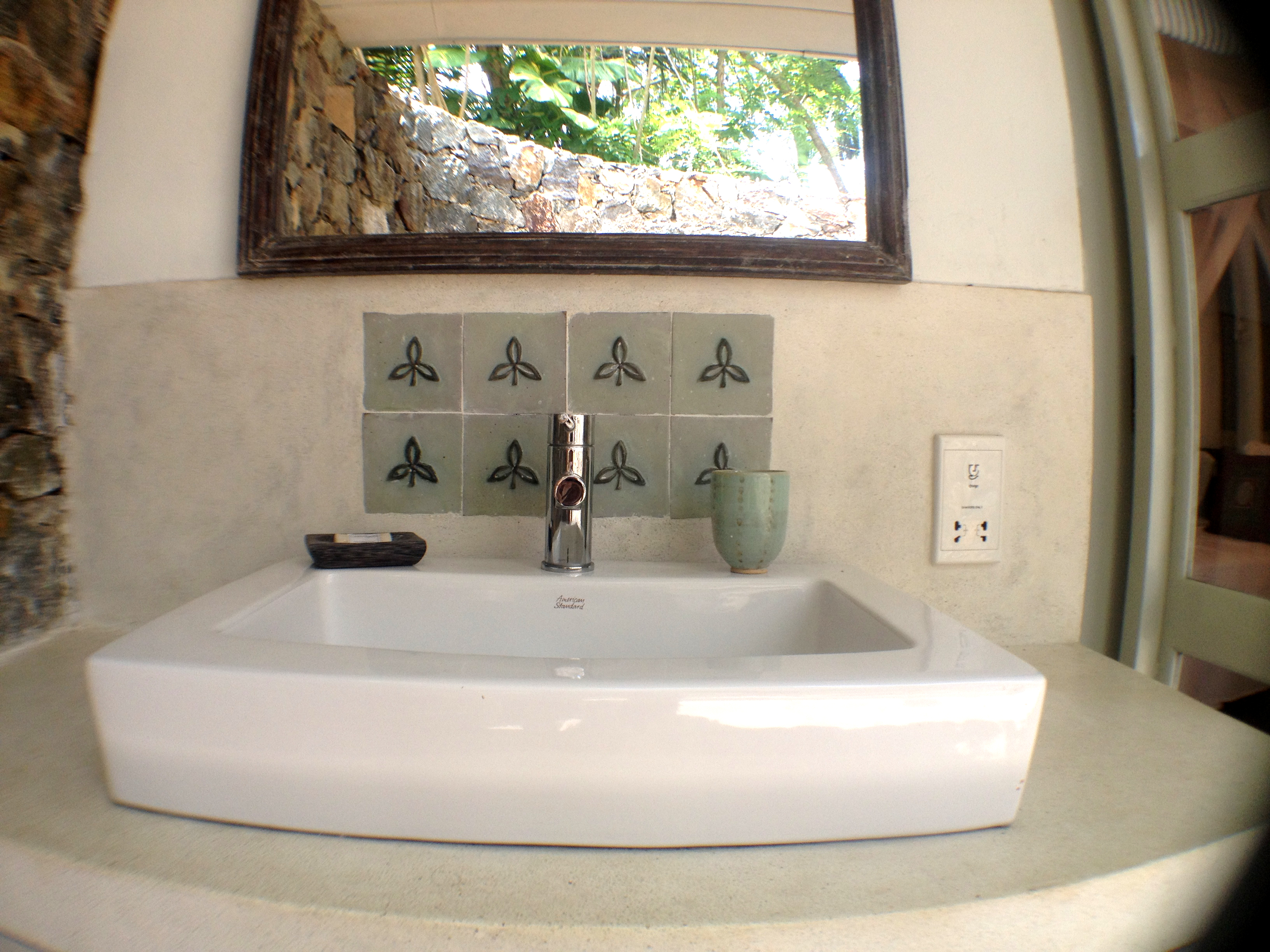 Basin in large inside/outside bathroom.