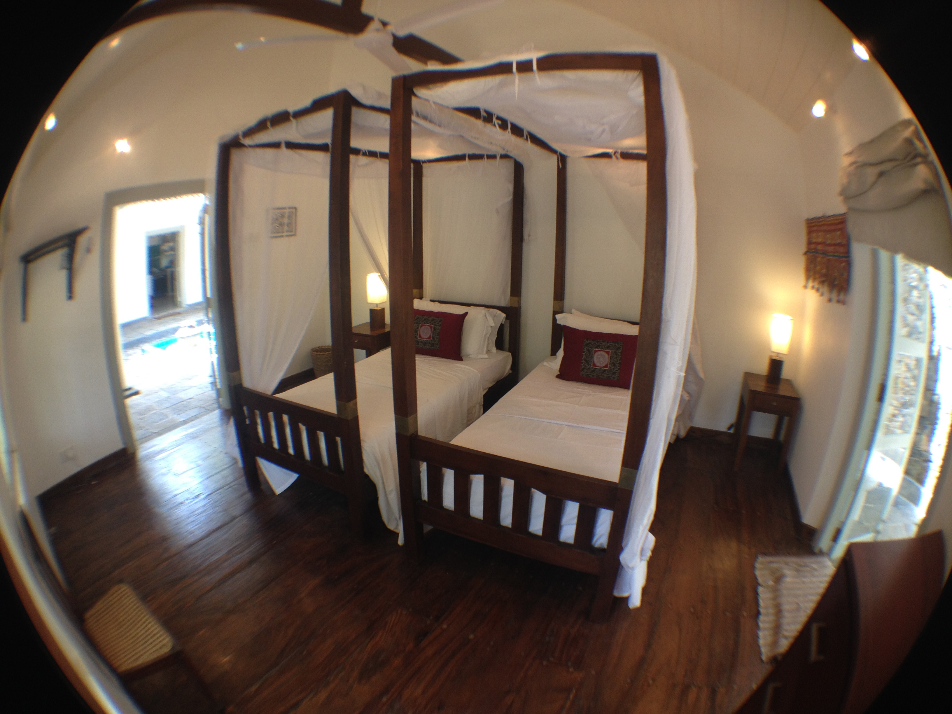 Room features wooden floor and a ceiling fan.