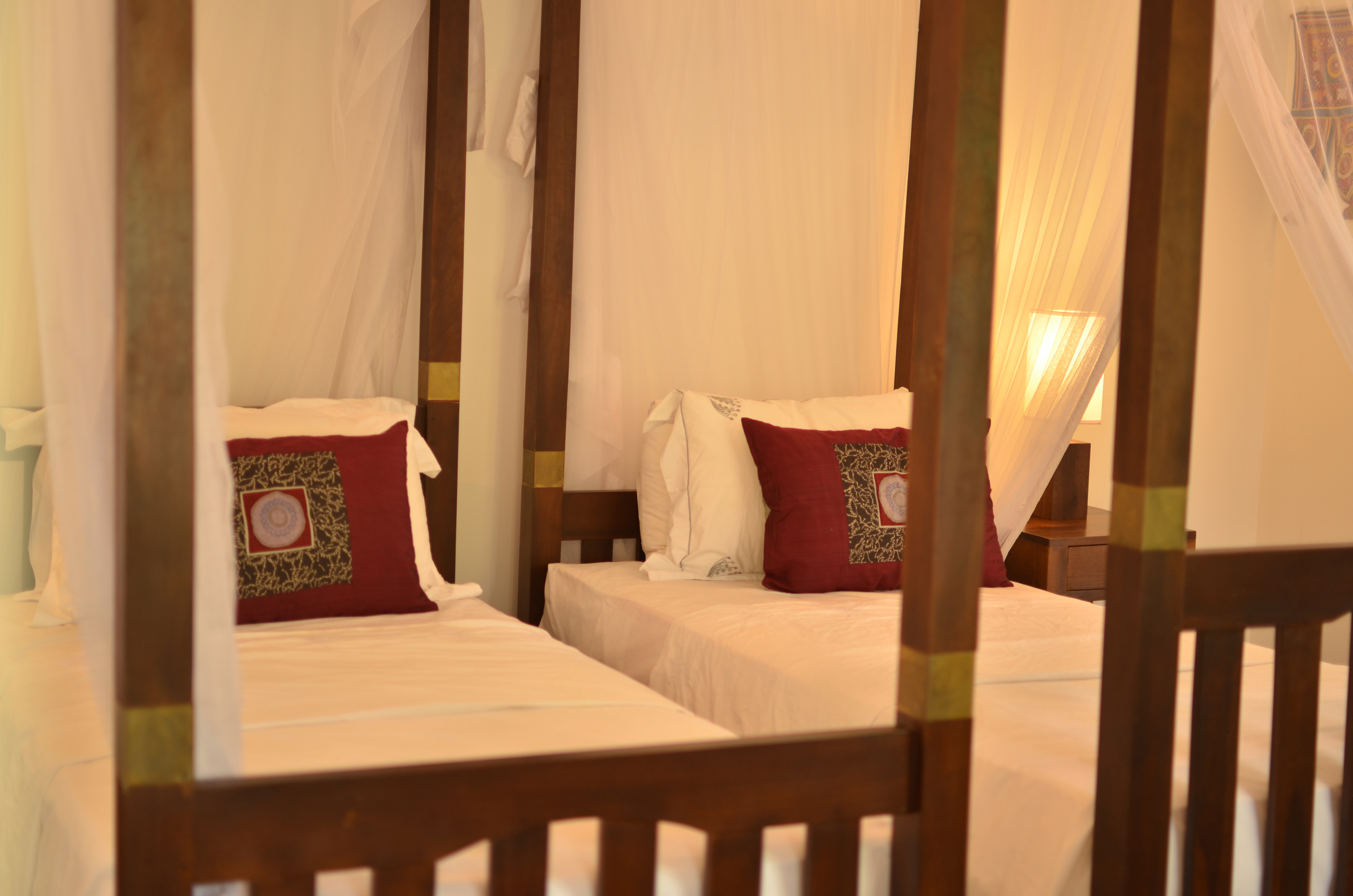 Super comfy four poster single beds with mosquito nets.